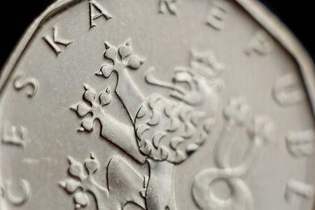 Coin two Czech koruna macro isolated on black background. Detail of metallic money close up. European country money Czech Republic.
