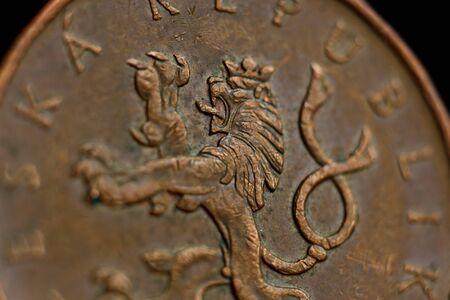 Coin ten Czech koruna macro isolated on black background. Detail of metallic money close up. European country money Czech Republic.
