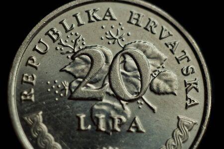 coin twenty croatian lipa macro isolated on black background. Detail of metallic money close up. money of european country croatia. Stock Photo