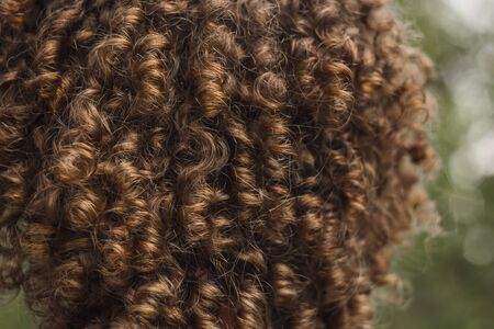 texture of male curly hair close up. perm for men. stylish hairdo.