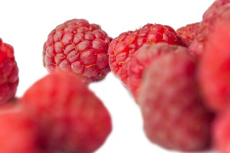 red raspberry berries close-up isolated on a white background. sweet summer medicinal berries macro details. Reklamní fotografie