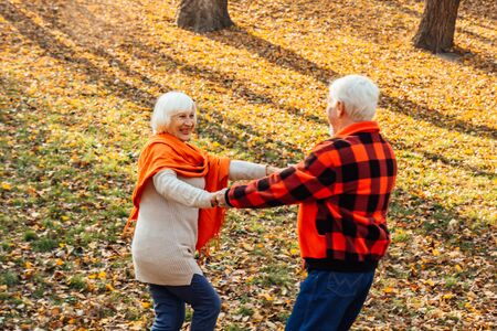 An elderly couple is dancing. Smiling old woman. Movement is life. I feel young again