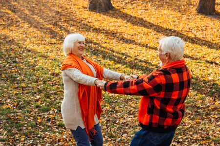 An elderly couple is dancing. Smiling old woman. Movement is life. I feel young again Imagens