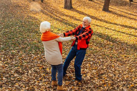 An elderly couple is dancing. Smiling old woman. Movement is life. I feel young again Stok Fotoğraf