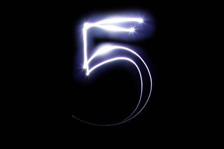 Set of numbers from neon light on a black background. Isolated top view, number 5 Stock fotó