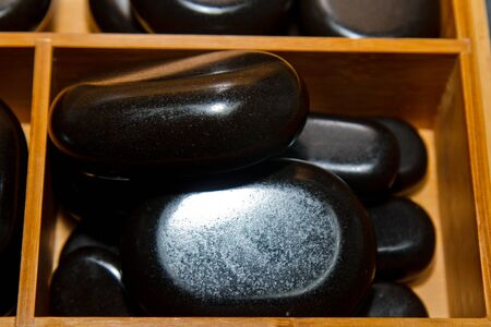 Special, professional set of hot stones for traditional massage. Preparation for the procedure of healing the soul and body