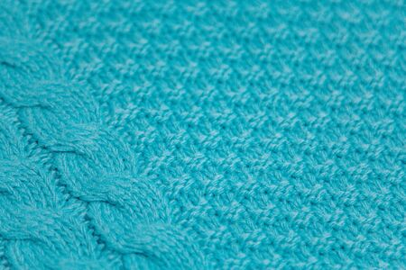 Pattern of colorful knitted sweaters closeup. Handmade merino wool product. Knitting patterns