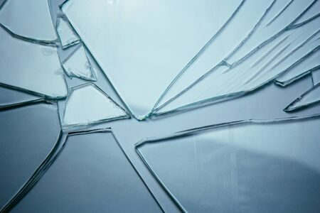 Broken glass background for your images isolated on white. Many large fragments of crumbled 스톡 콘텐츠