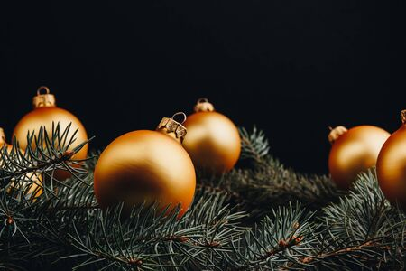 Colored christmas decorations on black wooden table. Xmas balls on wooden background. Top view, copy space. new year