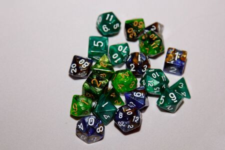 dices for board games, dnd and rpg scattered on light surface Stock Photo