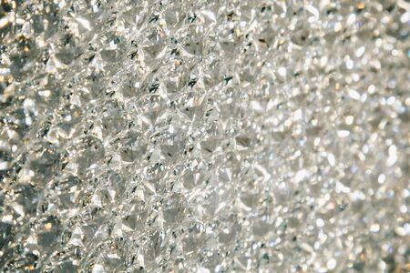 Beautiful shiny diamonds swarovski crystal background. Luxury, wealth. Cover pattern. Macro photo, close up of expensive stones