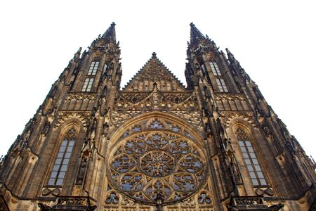 Prague. 05.10.2019: Perspective view of the Metropolitan Cathedral of Saints Vitus, Wenceslaus and Adalbert, an excellent example of Gothic architecture. Golden Gate South Tower with clock