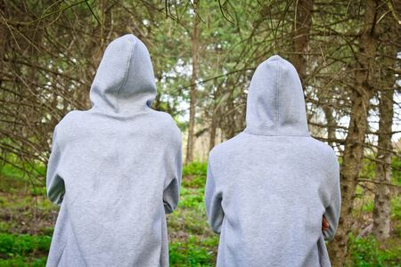 Beautiful, young guys in tracksuits play sports in the park outdoors. Healthy lifestyle Banco de Imagens