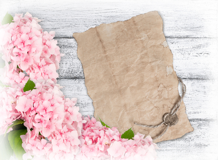 sealing: Hydrangeas and old paper with sealing wax on background of shabby wooden planks Stock Photo