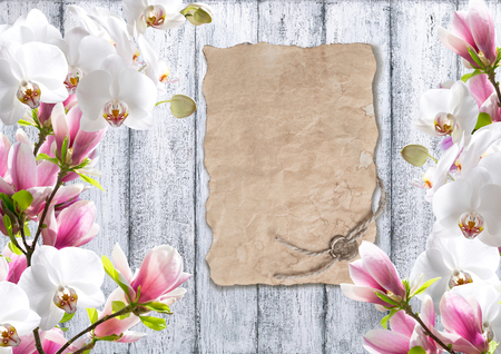 sealing: Magnolia flowers with orchid and old paper with sealing wax on background of shabby wooden planks in rustic style