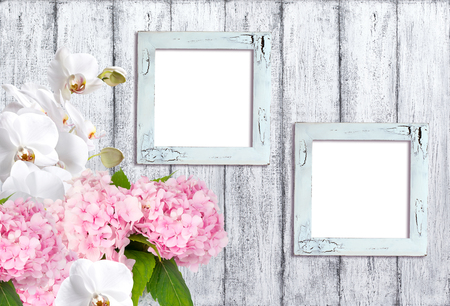 craquelure: Hortensia flowers with orchidea and photo frames on background of shabby wooden planks in rustic style Stock Photo