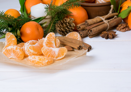 Christmas background with tangerines, spruce and spices