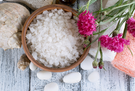 Spa salon with sea salt and flowers