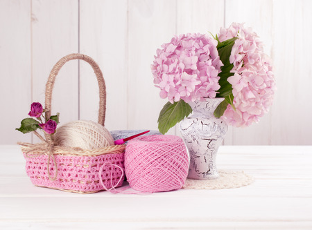craquelure: Yarn for crochet and  basket for handmade on white wooden boards in shabby chic style