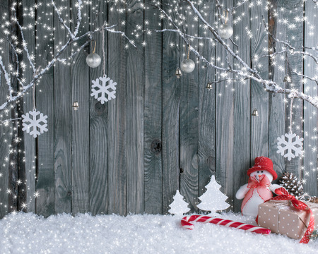 Christmas interior with decorative branches, presents and candy canes on wooden planks background. New Year winter composition. Stock Photo