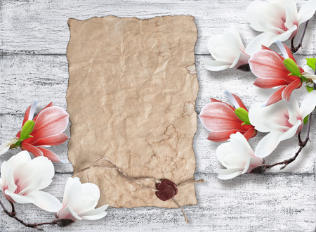 sealing: Magnolia and old paper with sealing wax on background of shabby wooden planks