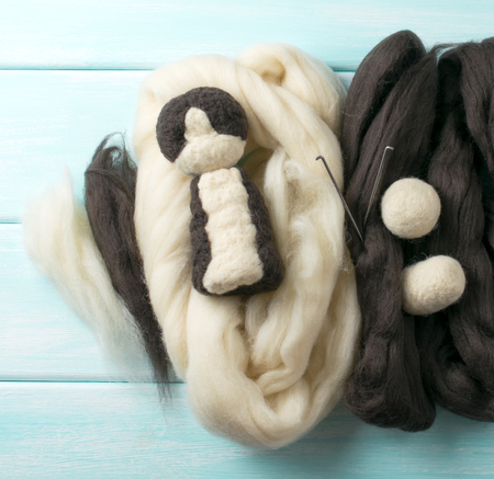 carding: Workspace with tools needle and skeins of wool for felting toys. Master class. Top view. Stock Photo