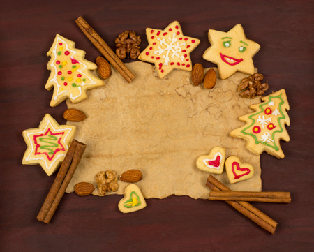 gingerbread: Old paper with Christmas cookies, nuts, cinnamon and place for text Stock Photo