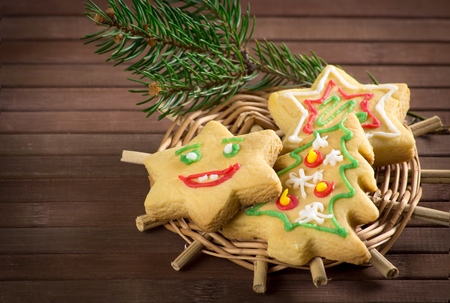 gingerbread: Christmas funny cookies and spruce branches