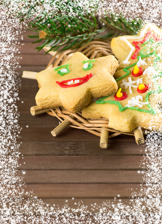 Christmas funny cookies with  spruce branches and snow Stock Photo
