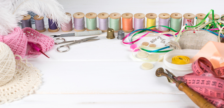 Set for sewing, knitting and needlework on a wooden board in Shabby Chic style Stock Photo