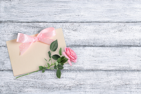 Rose flowers on background of shabby wooden planks in rustic style