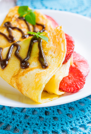 hotcakes: Pancakes with sliced strawberries and chocolate Stock Photo