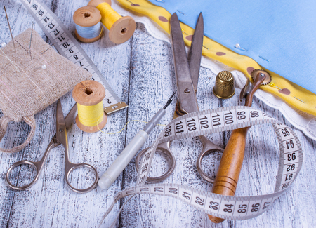 pin board: Tools for sewing and fabric on wooden boards  in Shabby Chic style.