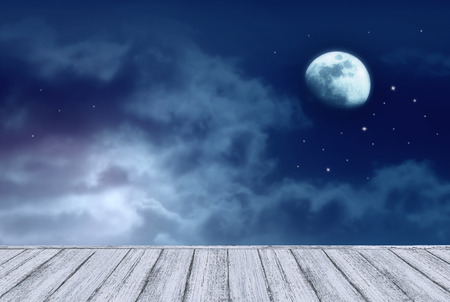 Background of night sky with mysterious clouds, moon, stars and table in shabby chic style. Moon is taken by me with my camera. Stok Fotoğraf