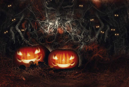 Halloween autumn festive still life with two evil smiling glowing jack o lantern pumpkins on straw and ghost bats eyes on terrible spooky background of tangled tree roots in scary dark bloody colors