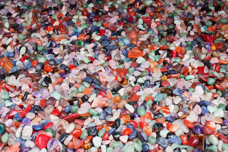 Natural background - pile of semi precious jewelery stones closeup. best for craftmanship, interior design