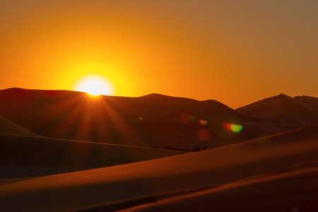 Sunset over the sand dunes in the Namib desert.