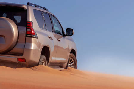 Close up of a golden car stuck in the sand in the Namib desert. Walvis Bay. Namibia. Africa