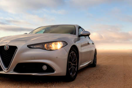 Alfa Romeo Giulia standing in the middle of the desert 12.02.2021. Walvis Bay, Namibia