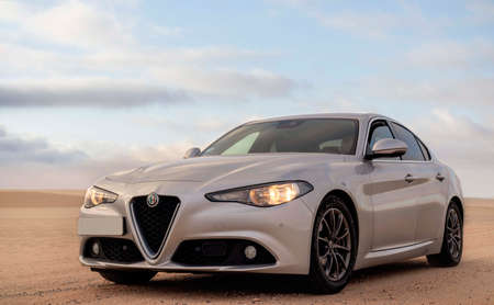 Alfa Romeo Giulia standing in the middle of the desert 18.03.2021. Walvis Bay, Namibia