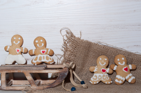 miracle tree: cookies in the shape of a little man near sled