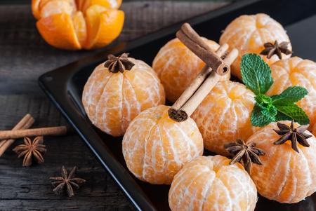 anisetree: Peeled fresh juicy tangerine, anisetree and cinnamon