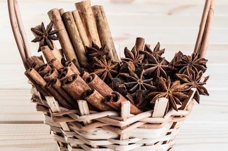 anisetree: fragrant anisetree and cinnamon stacked in a wicker basket