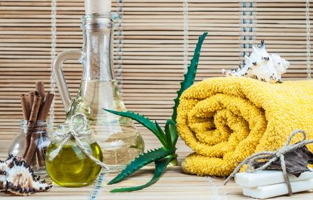olive green: spa, oil, aloe leaves, cinnamon, handmade soap Stock Photo