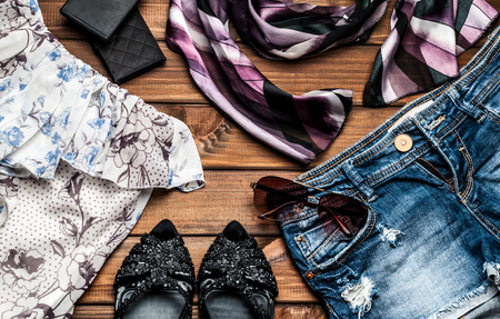 blouses: jeans and fashion accessories on wooden boards