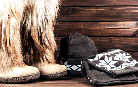 Stylish womens winter boots with fur, scarf and hat