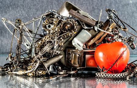diverse iron pieces adhere to the magnet and red heart Stock Photo