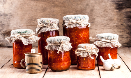 homemade canned vegetables in jars on a wooden table