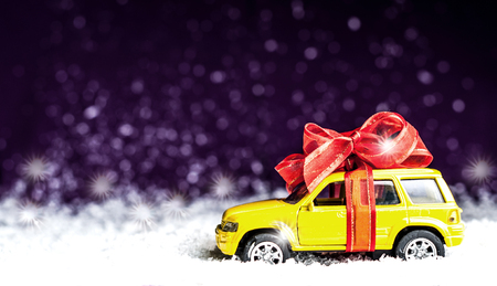 the jeep: small car with red decorative bow in snow