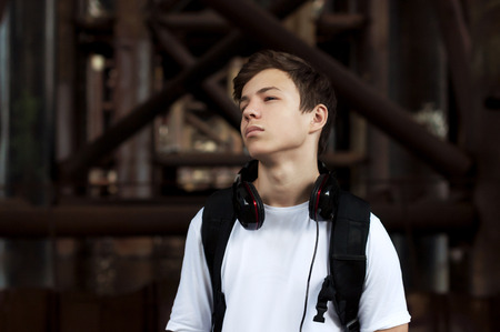 Stylish young man in headphones listening to music Stock Photo